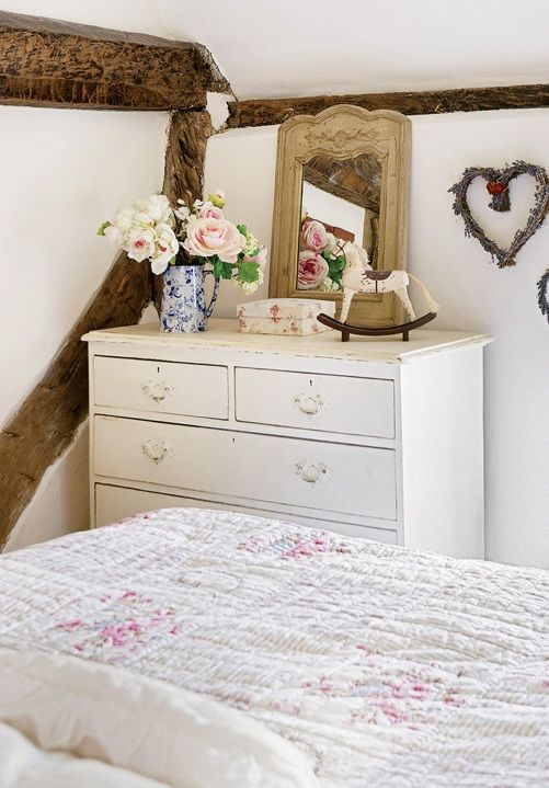 Country cottage bedroom with painted chest of drawers