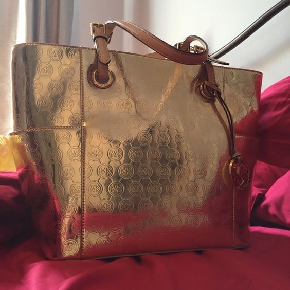 Gold Michael Kors tote New with tags. No flaws. Still has tissue paper in it. Michael Kors Bags Shoulder Bags