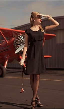 i love black dresses with polka dot tights!
