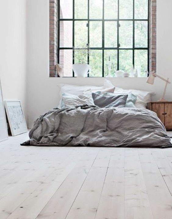 * A lot like A's bed. Mattress on the ground, messy, gray down comforter. Not so bright. See other picture for color scheme. *