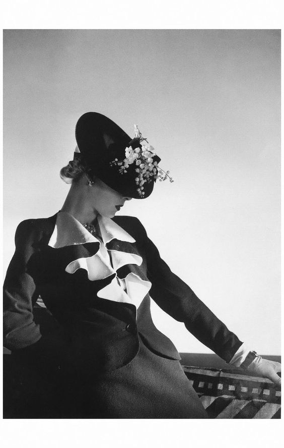 Helen Bennett in jacket and skirt by Molyneux, jewelry by Boucheron, 1938 Horst P. Horst. Image via Pinterest.