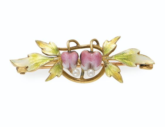 THE PRIVATE COLLECTION OF JOAN RIVERS: AN ART NOUVEAU ENAMEL AND SEED PEARL BROOCH. Designed as two pink enamel and pearl bleeding heart flowers, extending green enamel leaves, mounted in gold.