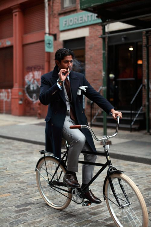 this picture is so great -- between him being so fancy, yet smoking on a bike. love the long navy coat, especially.