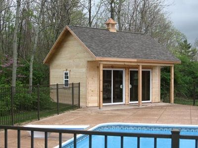 Pool house shed with porch and sliding glass doors for Sheds with porches for sale
