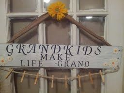 Made with reclaimed wood, twine, clothespins, ribbon and flower appliques.
