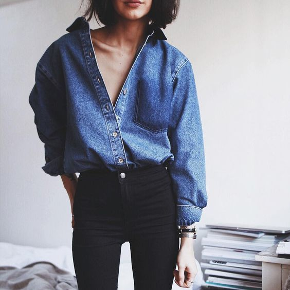 Oversized denim top paired with black skinny jeans.