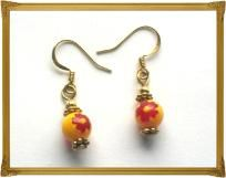 """This is a pair of 3/4"""" long earrings made with corrugated goldtone rounds, goldtone studded beads, and yellow China Glass beads with Red Floral centers.  These have hypo-allergenic goldtone ear wires.   Thanks for looking and feel free to ask any q..."""