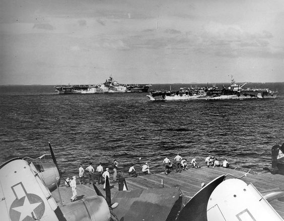 The light aircraft carrier Langley (CVL 27) and carrier Hornet (CV 12) pictured underway in the Pacific Ocean as seen from the carrier Lexington (CV 16) on January 25, 1945, sixty-eight years ago today.