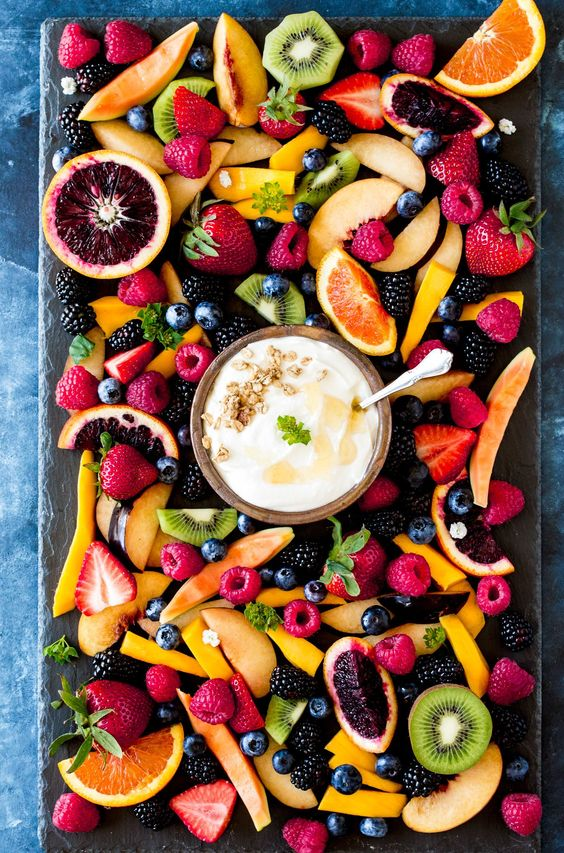 This fresh fruit board with ricotta blend is complete with granola and wildflower honey toppings and is the perfect brunch idea for a crowd.