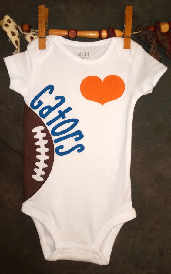 This Florida Gators onesie is perfect for any Gators fan that has a little mini fan!! The heart and letters are appliqued in the team colors. This