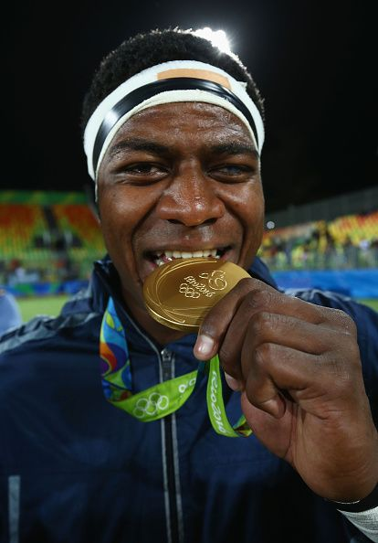 #RIO2016 Ro Dakuwaqa of Fiji celebrates with his gold medal after the medal ceremony for the Men's Rugby Sevens on Day 6 of the Rio 2016 Olympics at Deodoro...