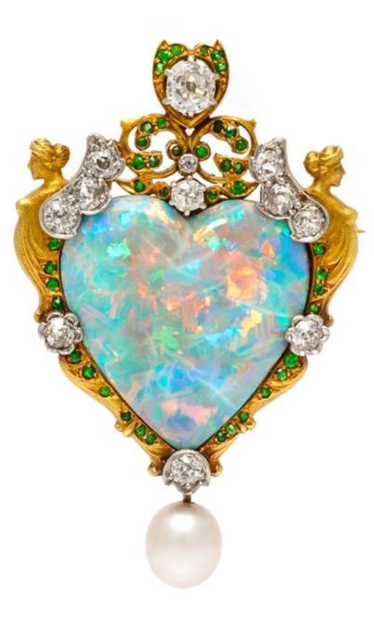 Paulding Farnham for Tiffany & Co. - An Important Renaissance Revival Gold, Platinum, Opal and Multigem Pendant/Brooch. Composed of two Classical female figures at the shoulders of a central heart shape crystal opal within an engraved and open filigree work surround, containing round demantoid garnets, surmounted with platinum accents set with one old mine cut diamond and 10 old mine cut diamonds, the base suspending an oval pearl. Stamp: T&CO.: