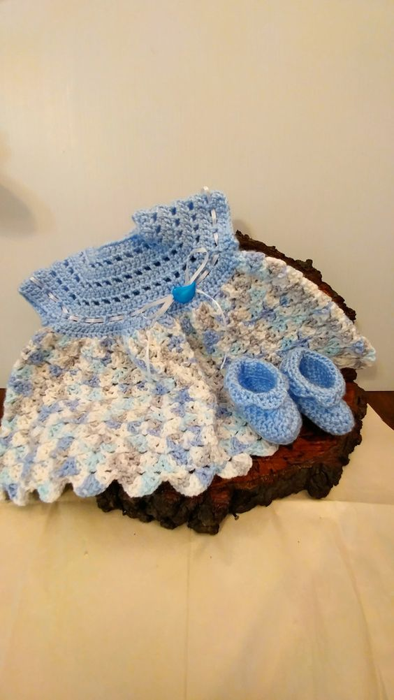 Baby Dress made with shades of blue and white. The set has matching booties. A little blue bird button on front. This button is sewed with 3 separate threads. This is to make sure if a little one bite: