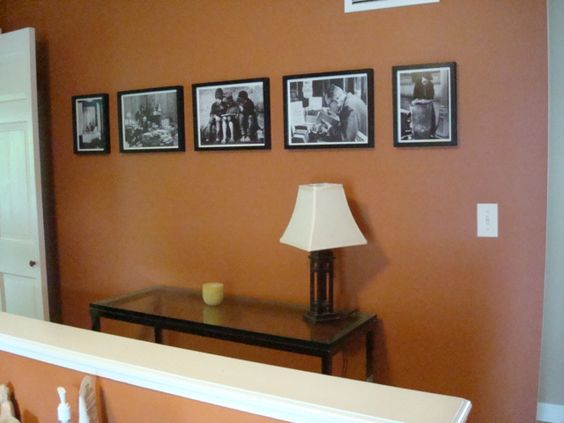 black & white photos on burnt orange wall color | new house