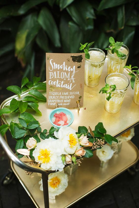 Vintage drink cart with the bride and groom's signature drink | Flowers by poppyandmintfloral.com | Photo by Tasha Rae Photography