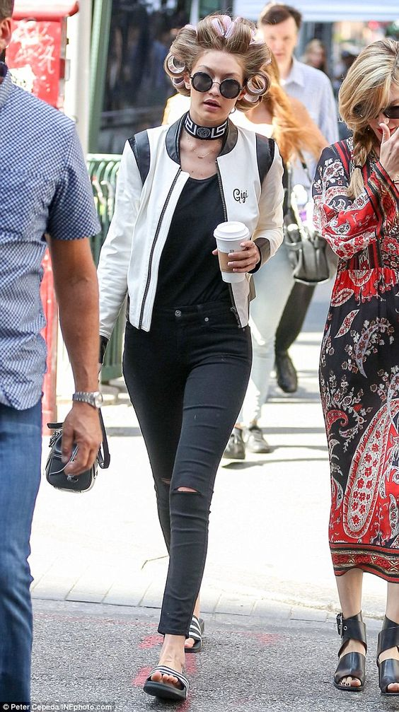 Gigi on the move: The blonde stunner was on her way to a Tommy Hilfiger editorial photo sh...