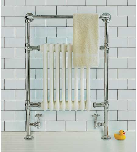 This towel warmer marries modern comfort in a period wrapping by plumbing a traditional column radiator directly into a house's hot-water heating system.  | Photo: David Prince | thisoldhouse.com
