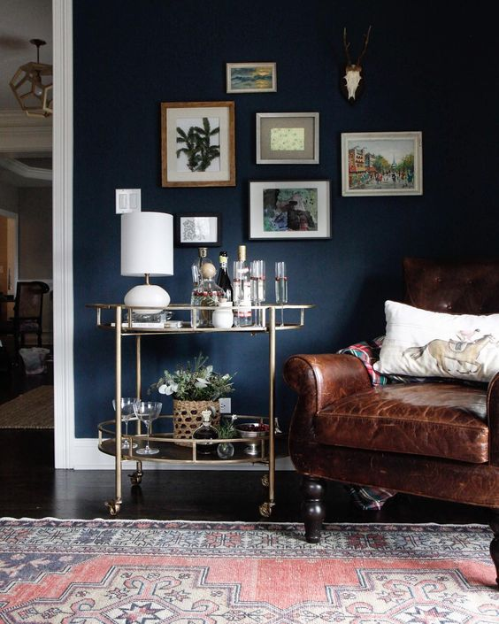 brass bar cart + dark living room walls via @citysage