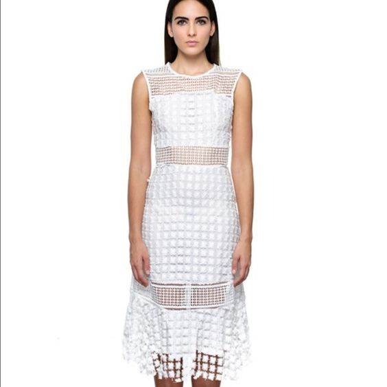 Cata Dress Feminine and edgy collide to create the Cata Dress. This gorgeous tea length dress is sleeveless and has a zipper closure in the back. The Cata dress is light weight and exposes just the right amount of skin through its unique eyelet detailing. Style Mafia Dresses