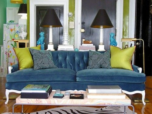 peacock blue sofa takes center stage against chartreuse, black and .