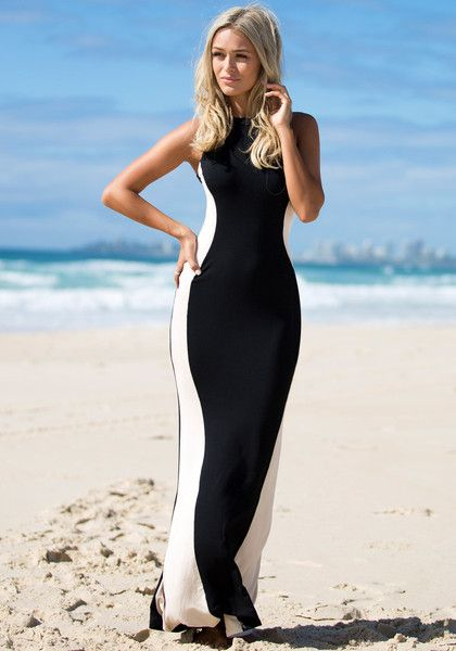 This glam maxi dress is sure to turn heads at a party. With its figure-hugging fit enhanced by a halter neckline and hourglass-shape paneling, the dress is sure to create an illusion of curves. | Lookbook Store