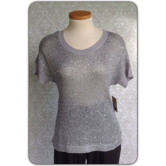 """ELLEN TRACY SEQUIN KNIT TOP Silver yarn and sequins, grey ribbed neck and sleeve cuff. Slight dolman 18"""" across will fit small too. Has a small pull in back NOT at all noticeable price reflects. NWT Ellen Tracy Tops"""