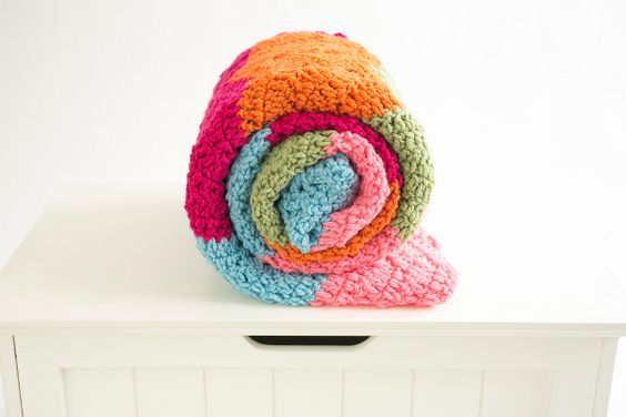 Over the Rainbow Afghan - Stripes of bright color give this afghan the punch it needs to liven up a drab room. Have fun playing with multiple shades to get just the right effect. From I Like Crochet's April 2014 issue