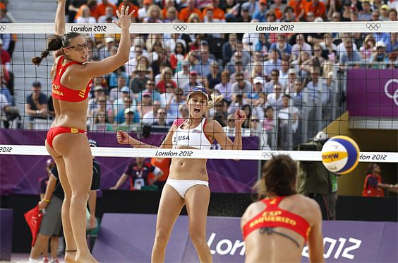 London Olympics Beach Volleyball Women    United States' Marleen Kessy, center, reacts as Spain's Liliana Fernandez and Elsa Baquerizo miss the ball during a beach volleyball match at the 2012 Summer Olympics