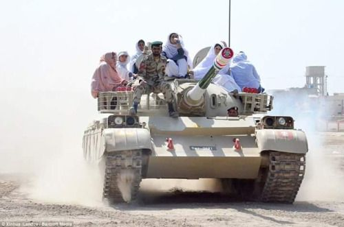 FEMALE STUDENTS ENJOYING RIDE ON AL-KHALID TANK, BY PAKISTAN ARMY. T-55/Type 59 successor tanks