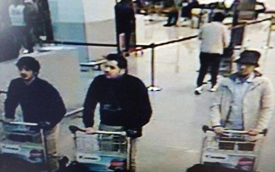 Belgians hunt Islamic State suspect after blasts kill 30