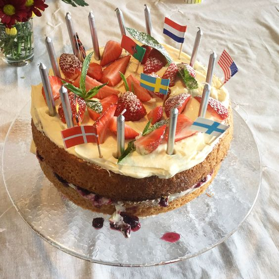 Victoria sponge with flags on top and fresh berry compote inside to celebrate my parents around the world party. Cake by @kentstreetdeli in rickingham Western australua