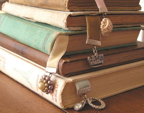 Velvet ribbon, clips from the craft store, and old jewelry bits. Makes a wonderful gift in your favorite book.