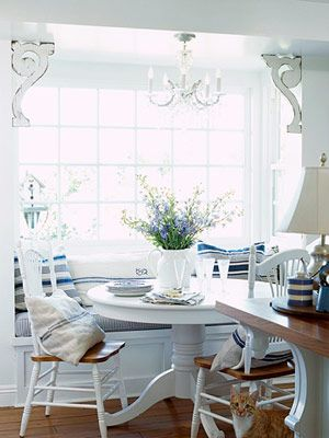 Bright white banquette with pops of blue.