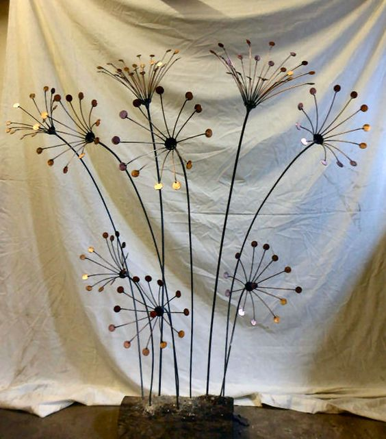flowers sculpture with pennies and welding wire
