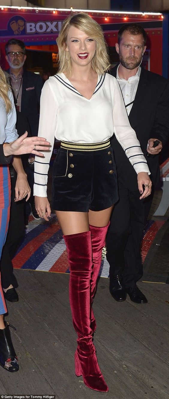 Simply stunning! Taylor Swift stopped the TommyNow show on Friday when she showed up in thigh-high red velvet boots and an ensemble plucked from Gigi Hadid's new Hilfiger collection: