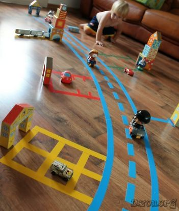 Use tape to make roads, parking lots and anything else your little one (or you) can think of!: