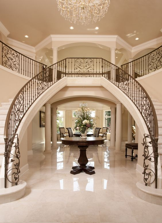 Luxury iron banister dual staircase grand entryway for Staircase ideas near entrance