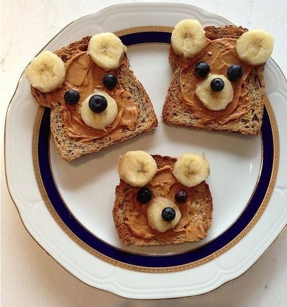 Cute bear peanut butter toast with bananas and raisins, chocolates or berries. Could be made with French toast too: