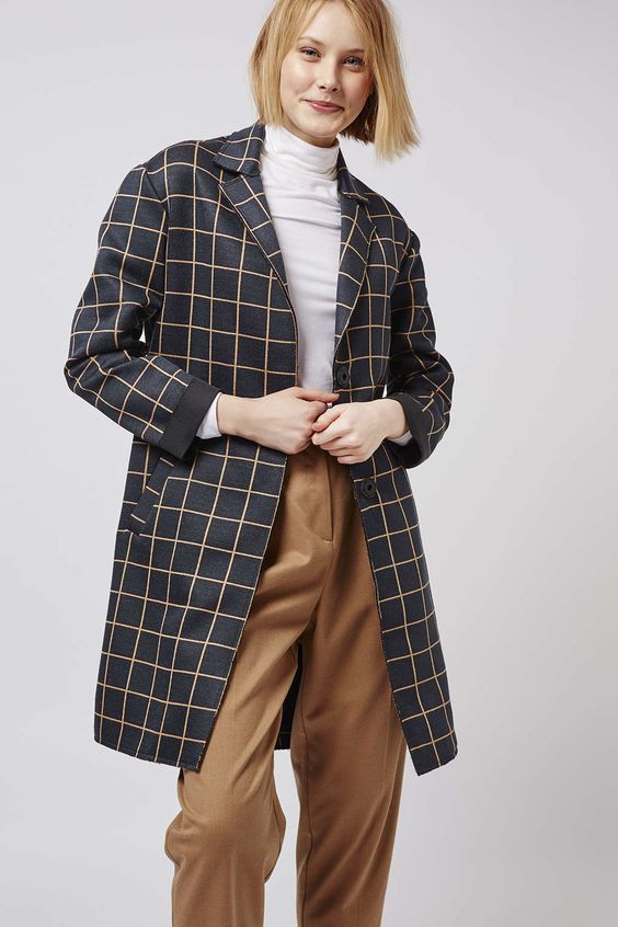 Trending checks make this duster style coat relevant for now. With popper fasting and practical