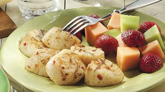 Add something flavorful to your family's Caribbean cuisine dinner night! Serve grilled scallops brushed with butter mixture that are ready in just 15 minutes.