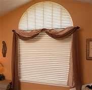 Stylish drapes over horizontal blinds