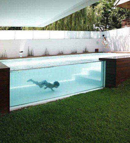 Piscinas con pared de cristal pools outdoor areas for Construccion de piscinas naturales en argentina