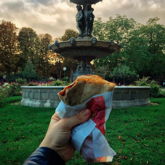 Enjoying a Nutella crepe in a garden near Ave Des Champs Elysess at dusk. Paris is teaching me how to relax and indulge.