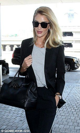 Rosie Huntington-Whiteley cuts a stylish figure as she flies out of LAX | Daily Mail Online
