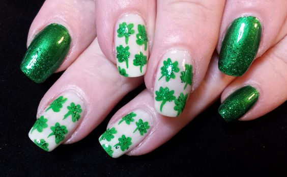 St. Patrick's Day manicure. Kelly green nails with sparkling shamrocks. Inspired by Robin Moses.