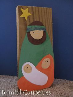 I love this simple nativity scene. made out of construction paper and a block of wood!