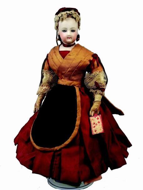 «Diseuse de Bonne Aventure» petite poupée parisienne avec tête en biscuit pressé…