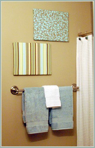 Make your own wall art! Get some fabric, an old canvas, staple gun, and custom create your own wall art!