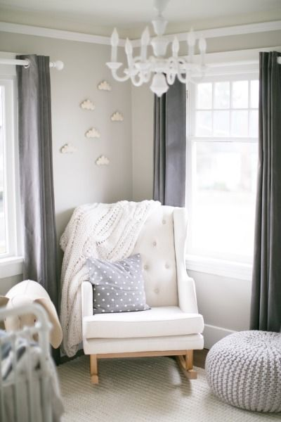 Love the simplicity of this nursing corner...with the clouds on the walls, various grey tones and a range of different soft fabrics.