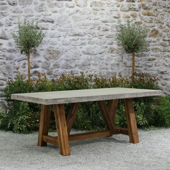 Outdoor tables on sale now. An outdoor table from our teak outdoor furniture collection makes it easy to entertain in style. The Bordeaux dining table is made of highly durable teak from our teak warehouse, with a solid concrete tabletop. Modern outdoor f